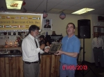 Dan Sharkey from Disabled American Veterans, Chpter 113 receiving a plaque from Herman Santa