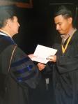 Edwin R. Massey, Ph.D. presenting a diploma to Samuel Villa 2014 Scholarship winner